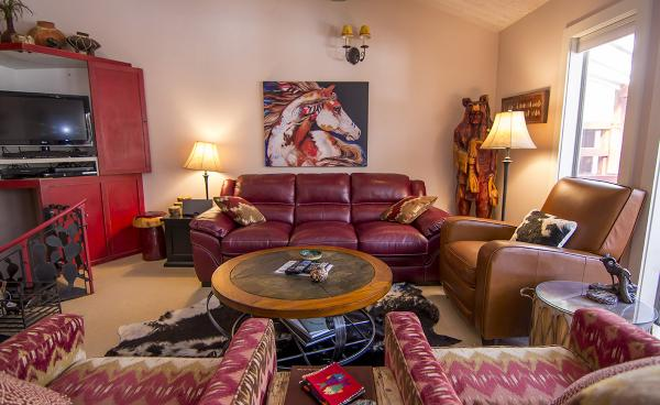 Modern western stylings in a red living room